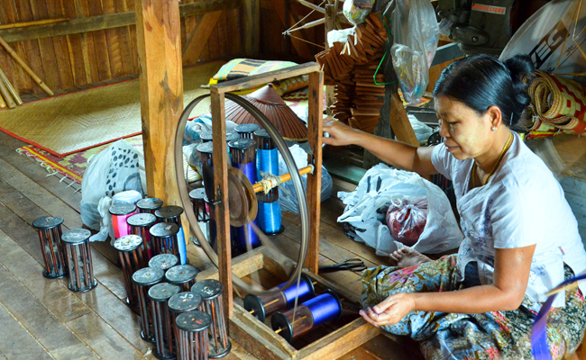 A woman spinning thread